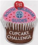 Our new Cupcake Challenge Badge with the Trefoil at its heart